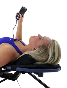 Pic of women using controller for Teeter Hang Ups vibration cushion for inversion tables.
