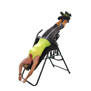 Health Mark Pro Inversion Table in use by women